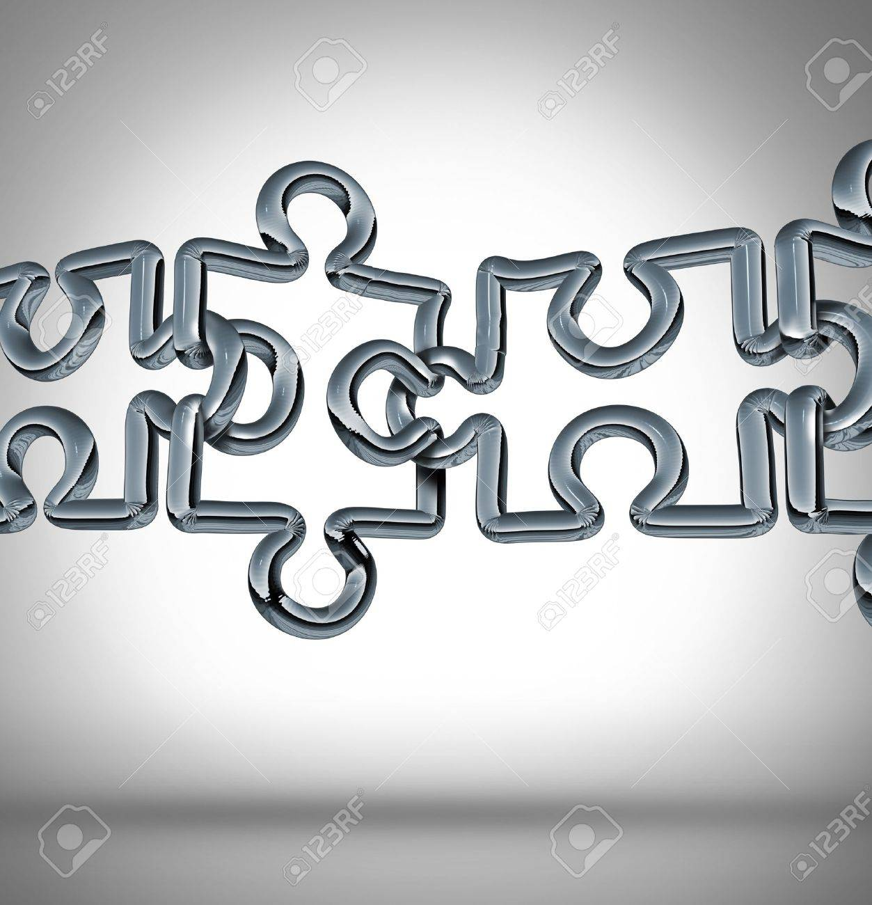Connection bridge and bridging the gap in business cooperation as a concept with a group of three dimensional metal chain links in a network shaped as puzzle pieces connected together to form a strong financial team Stock Photo - 17997203