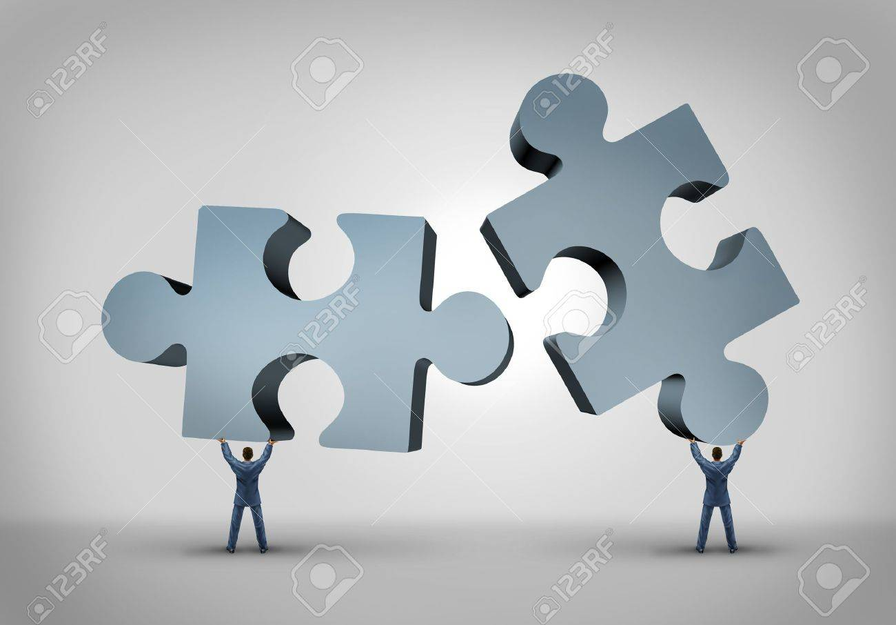 Teamwork and leadership business concept with two giant three dimensional puzzle pieces coming together from a partnership agreement between two powerful leaders who are building a successful company Stock Photo - 21492099