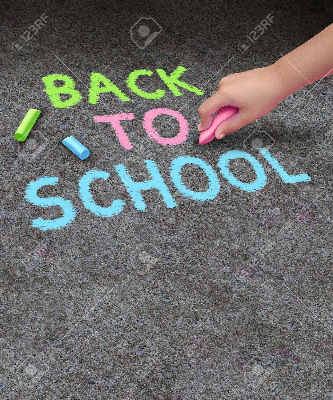 Back to school chalk drawing with blank area  for copy space on a concrete sidewalk with the hand of a child holding a color as a symbol of education and the start of the school year for learning Stock Photo - 21492123
