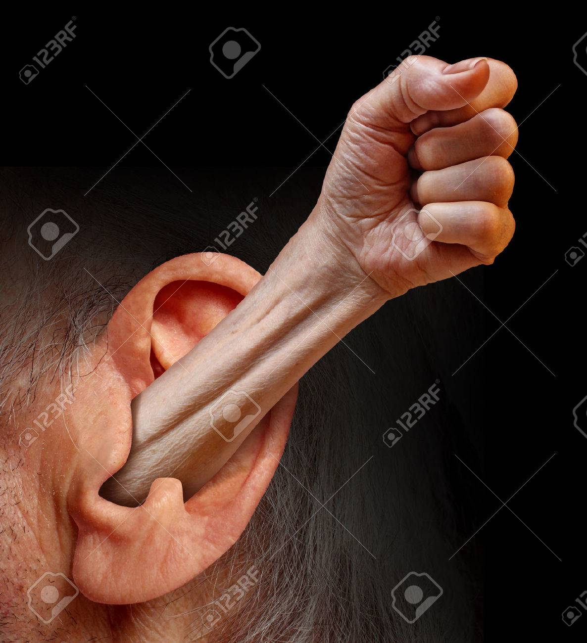 Power of being listened to and being heard as a social psychology concept of communication respect fighting for the rights of people and emotions as an arm with a fist emerging out of a human ear Stock Photo - 22667280