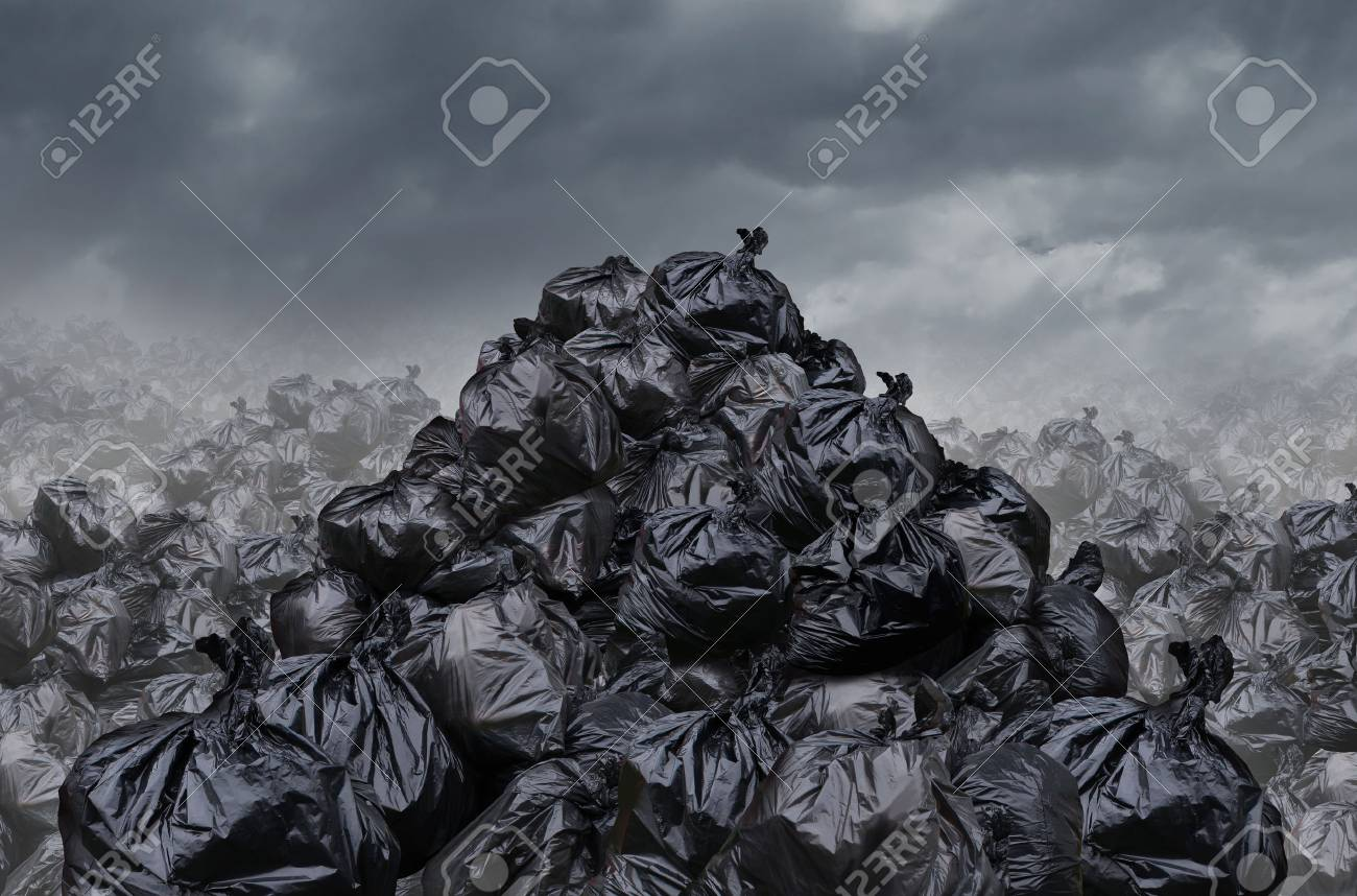Garage dump concept with mountains of black waste bags of trash with an unpleasant smell in an infinite landfill heap landscape as a background of