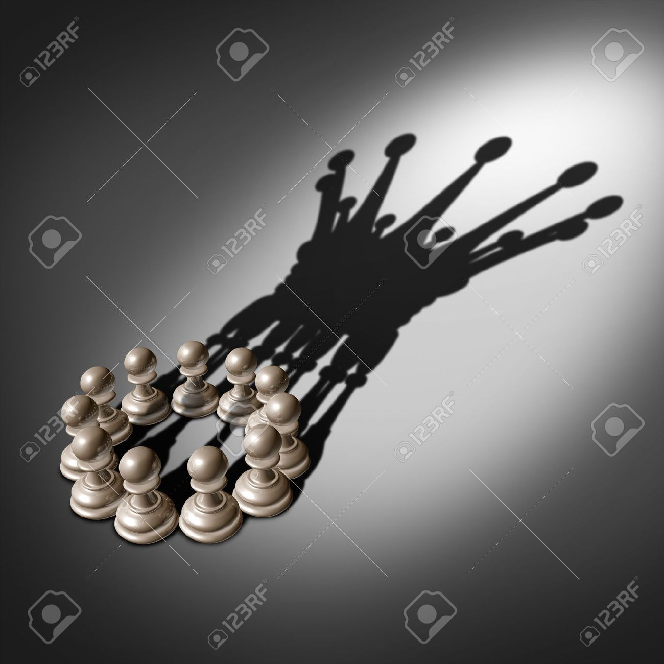 Leadership team and business group concept as an organized company of chess pawn pieces joining forces and working together united and as one in agreement to cast a shadow shaped as the crown of a king - 29806470