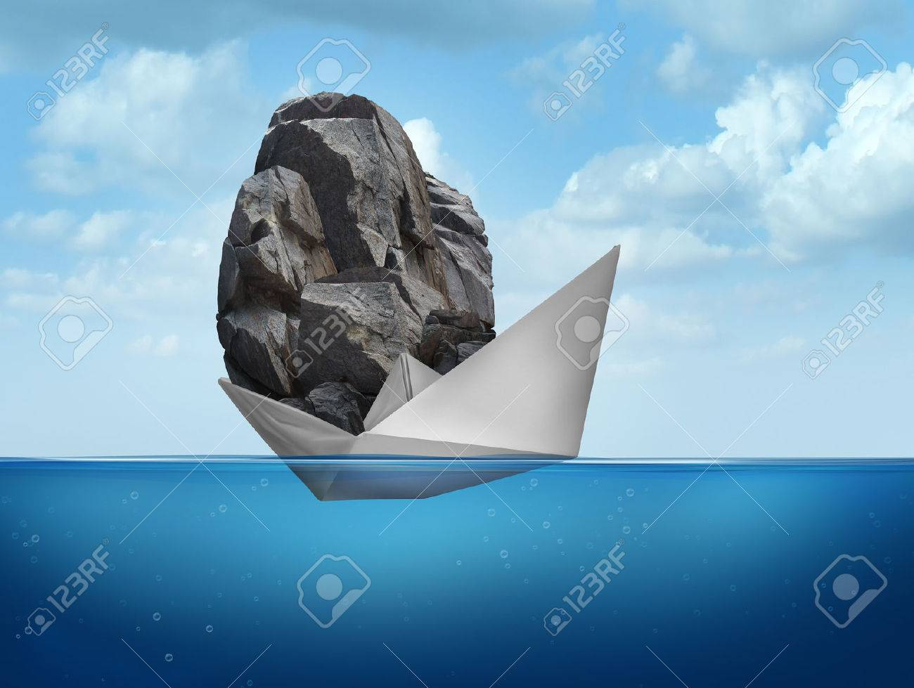 Impossible concept as a paper boat transporting a heavy rock boulder as a business symbol for overachieving and the power of determined potential to do things that are unbelievable. - 38697532