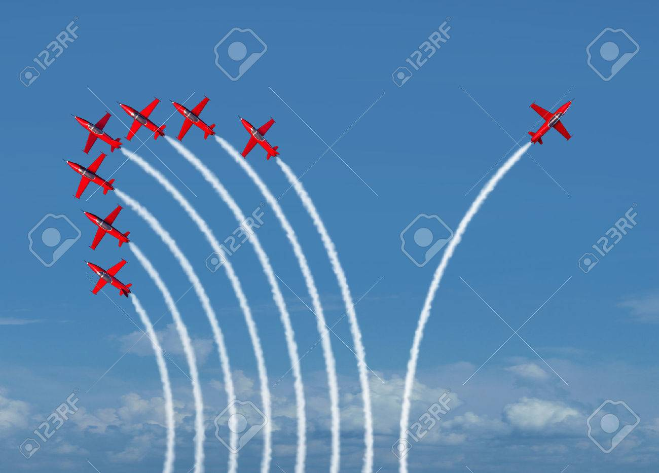 Independent innovation and new thinking concept or leadership symbol of individuality as a group of flying jet airplanes with one individual airplane going in the opposite direction as a business icon for innovative thinker. - 44032850