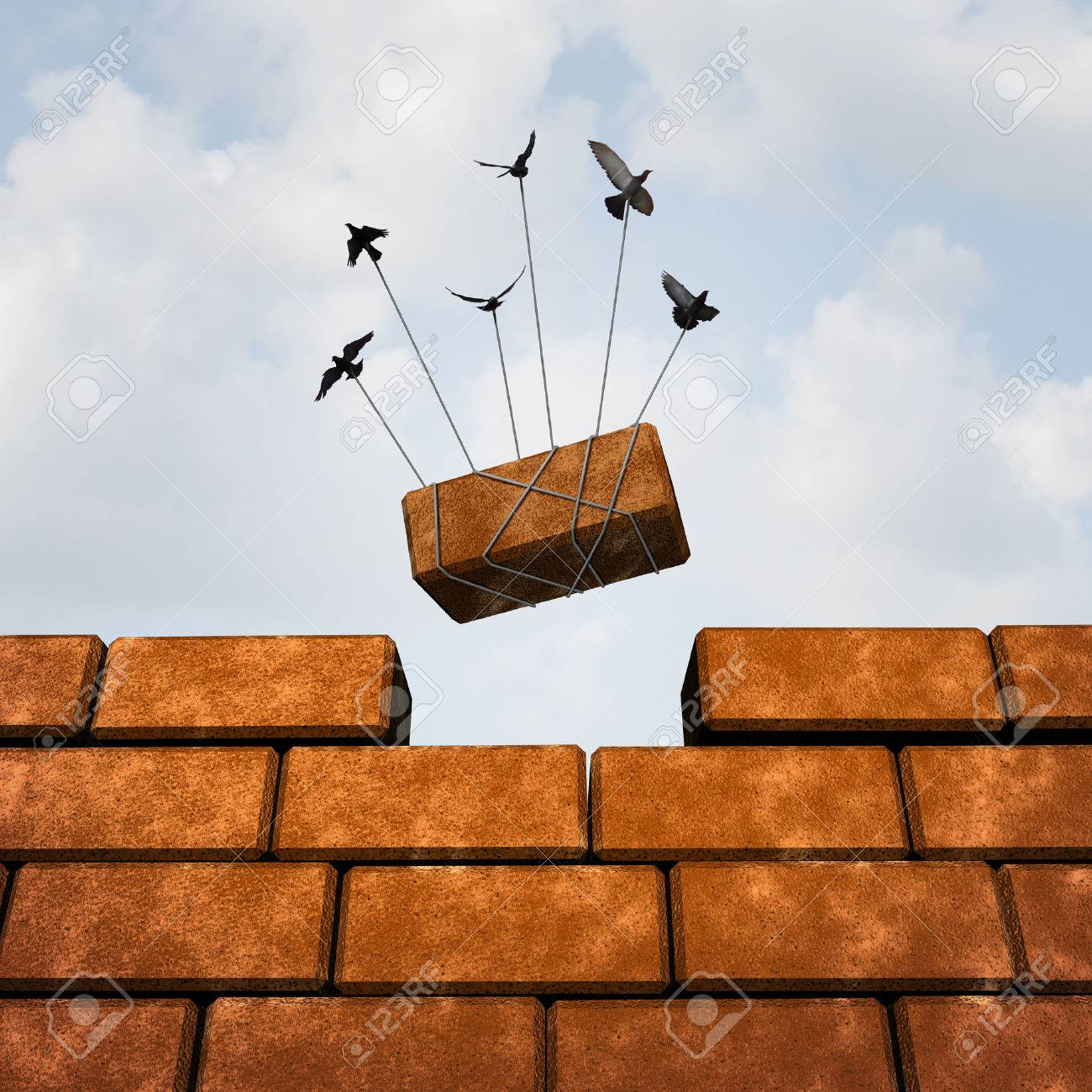 build a wall business concept as a group of birds placing a brick to complete a build wall