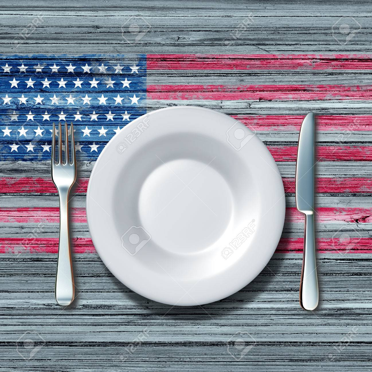 American cuisine food concept as a place setting with knife and fork on an old rustick wood table with a symbol of the flag of the united states as an icon of traditional family eating in america. - 49949650