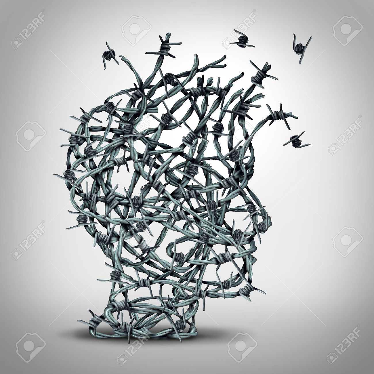 Anxiety solution and freedom from fear and escape from tortured thinking and depression concept as a group of tangled barbwire or barbed wire fence shaped as a human head breaking free as a metaphor for psychological or psychiatric icon. - 50923995