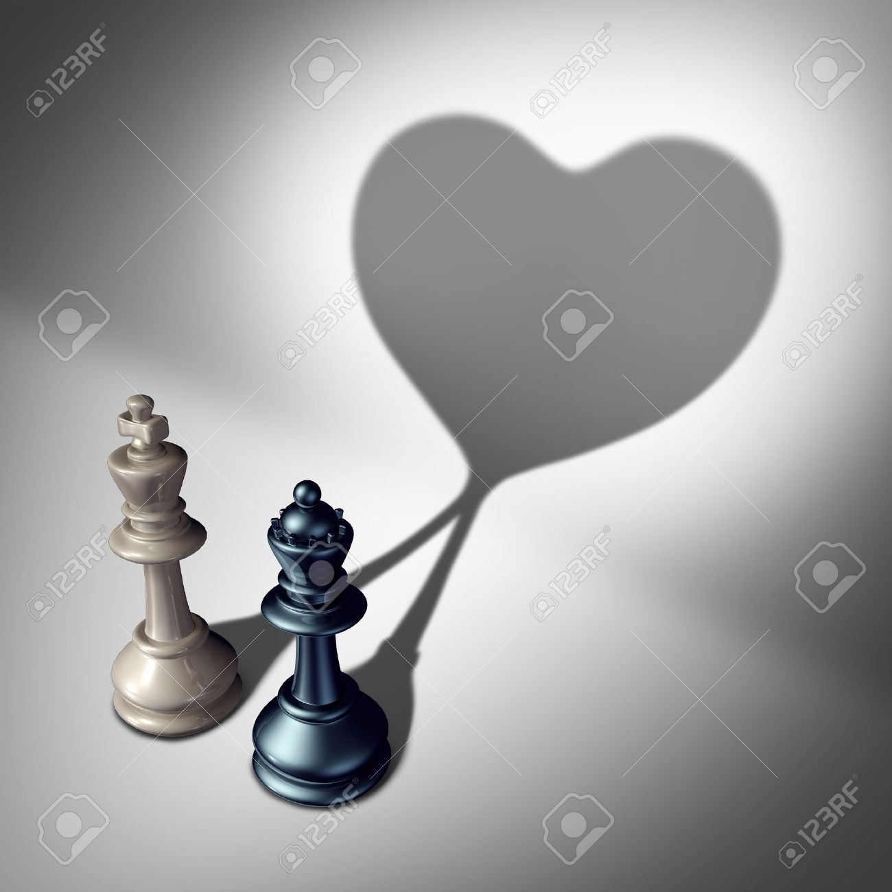 Couple in love as a valentines day concept as a white king and black queen chess piece casting a united cast shadow coming together in a romantic