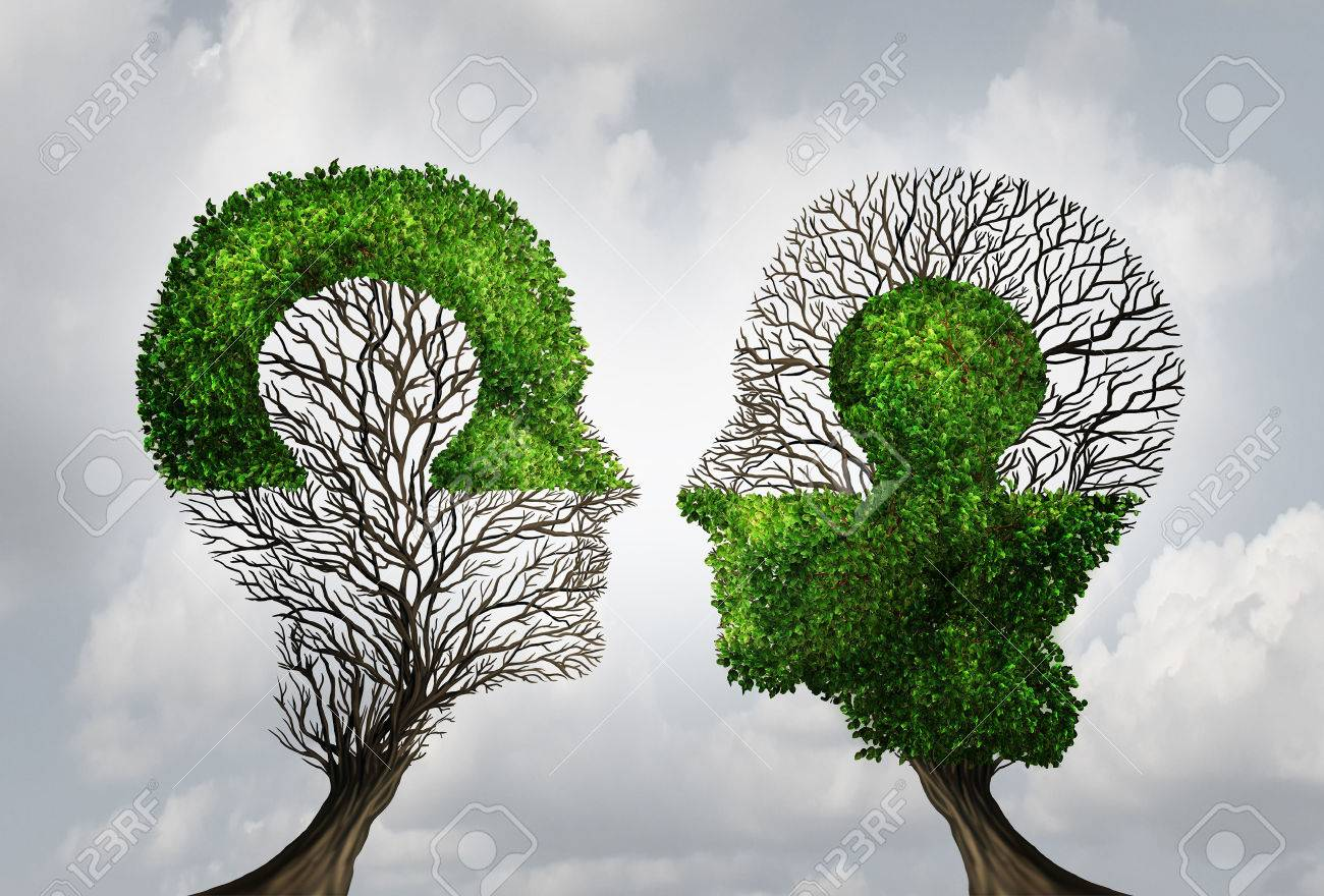 Perfect business partnership as a connecting puzzle shaped as two trees in the form of human heads connecting together to complete each other as a corporate success metaphor for cooperation and agreement as equal partners. - 50924297