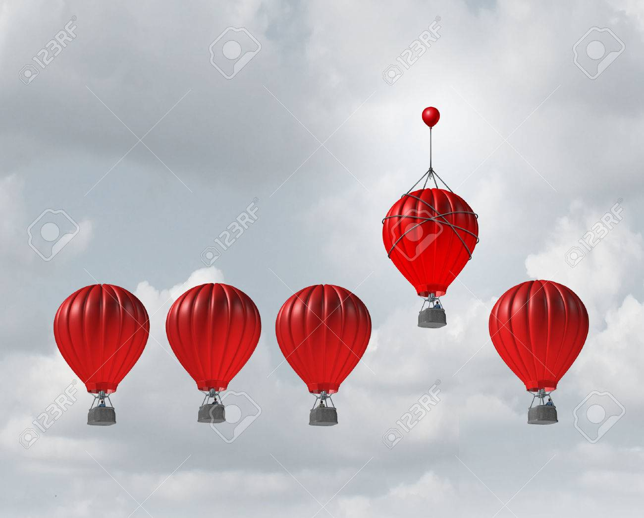 Competitive edge and business advantage concept as a group of hot air balloons racing to the top but an individualleader with a small balloon attached giving the winning competitor an extra boost to win the competition. - 52657727