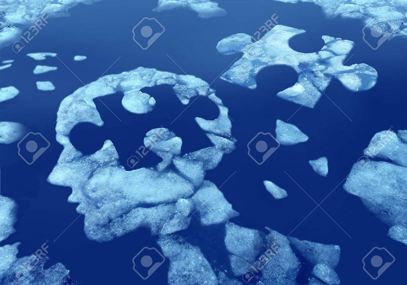 Puzzle head idea and concept as a human face profile made from floating icefloating away in water with a jigsaw piece cut out on a cold blue arctic background as a mental health symbol. - 52657746