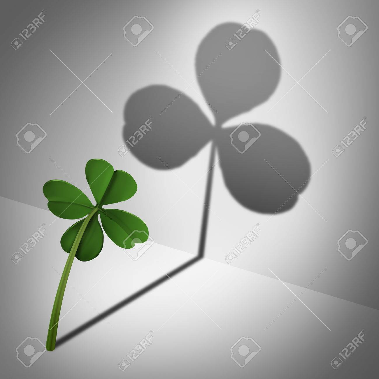 Low self esteem psychological concept as a four leaf clover casting a shadow with only three leaves as a mental health condition of feeling inadequate or negative thinking and low self confidence. Stock Photo - 54085815