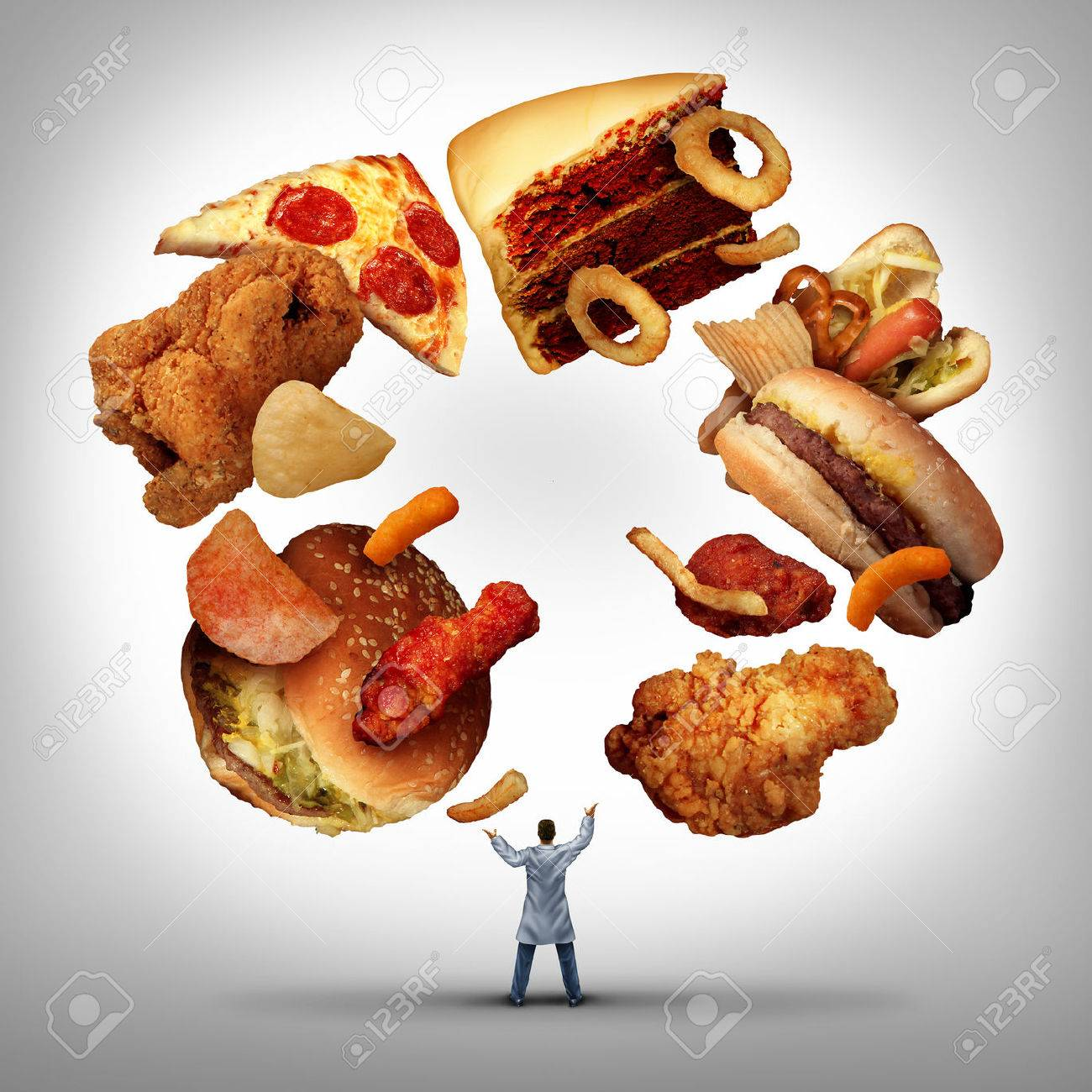 Nutritionist doctor or dietician and dietitian professional unhealthy food concept as a medical physician juggling low nutritional value generic fatty snacks as a nutritionist eating habit advice. - 54533173