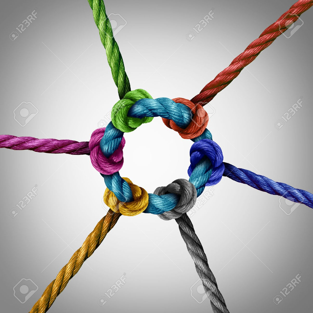 Central network connection business concept as a group of diverse ropes connected to a circle central rope as a network metaphor for connectivity and linking to a centralized support structure. Stock Photo - 56997806