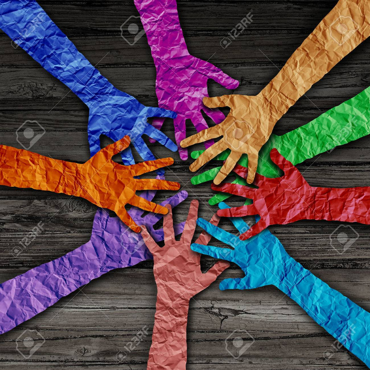 Diverse people team joining hands together as a partnership teamwork concept as a group of paper cut out hands as a diversity collaboration symbol in a 3D illustration style. Standard-Bild - 59356566