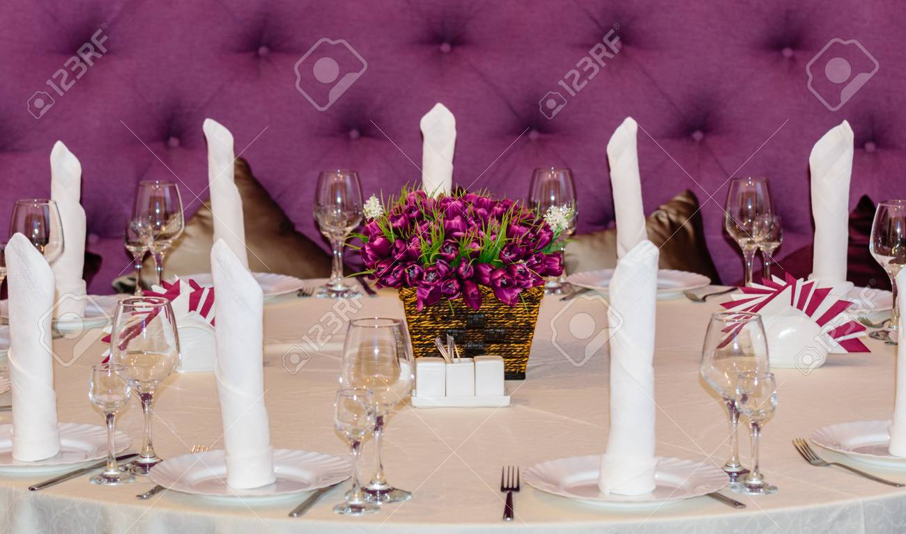 Decorated With A Round Table With Purple Armchairs Stock Photo   72358304
