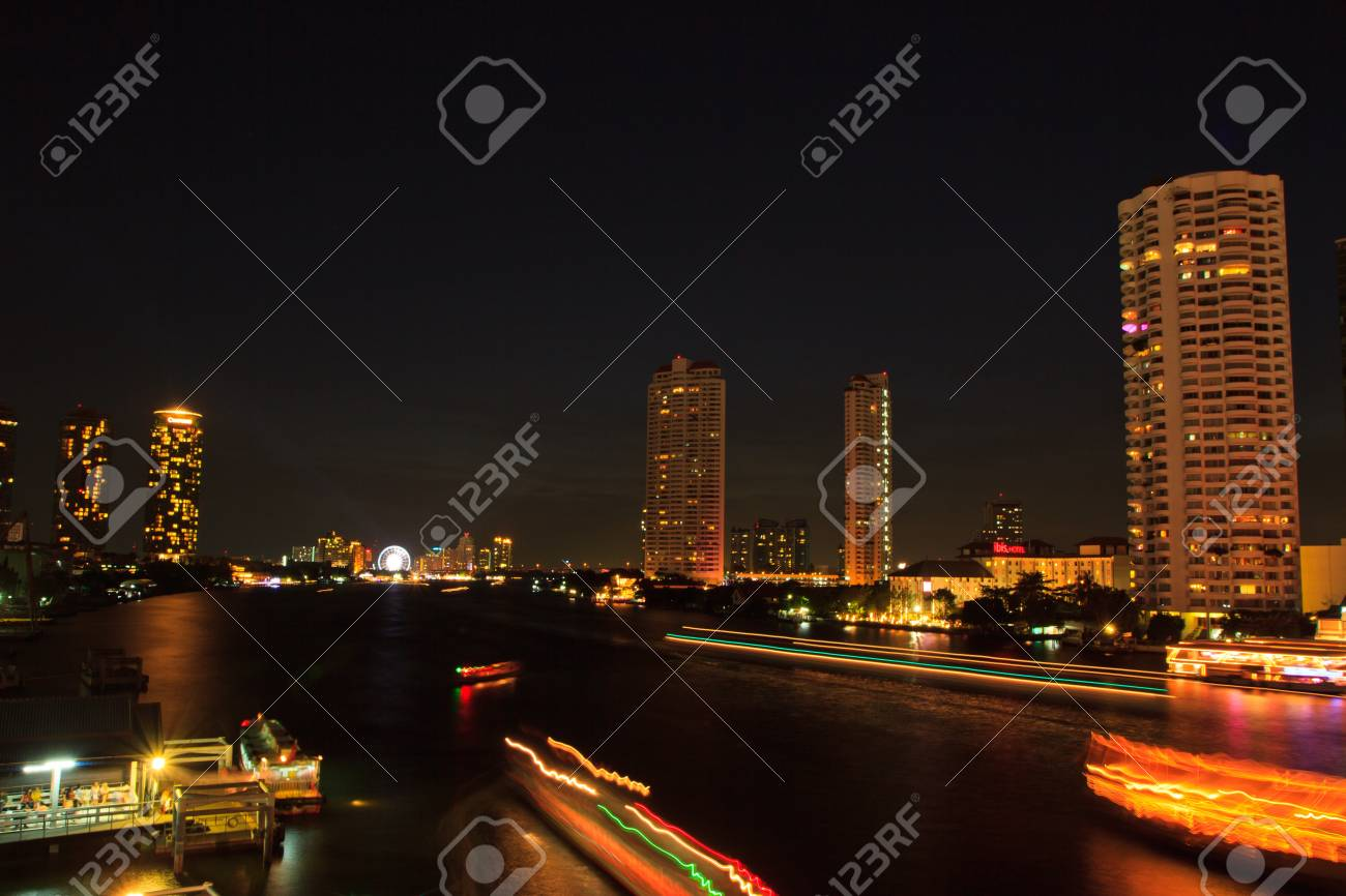 Bangkok city and boats in river  On sunset background, Thailand Stock Photo - 18045730