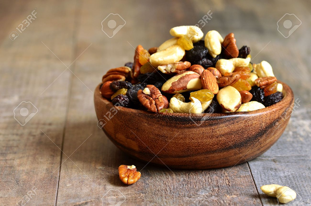 Dried fruits and nuts mix in a wooden bowl. - 35113836