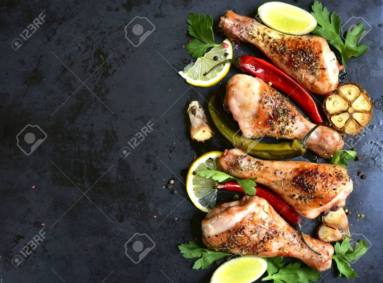 Grilled spicy chicken legs.Top view.Copy space background. - 52630309