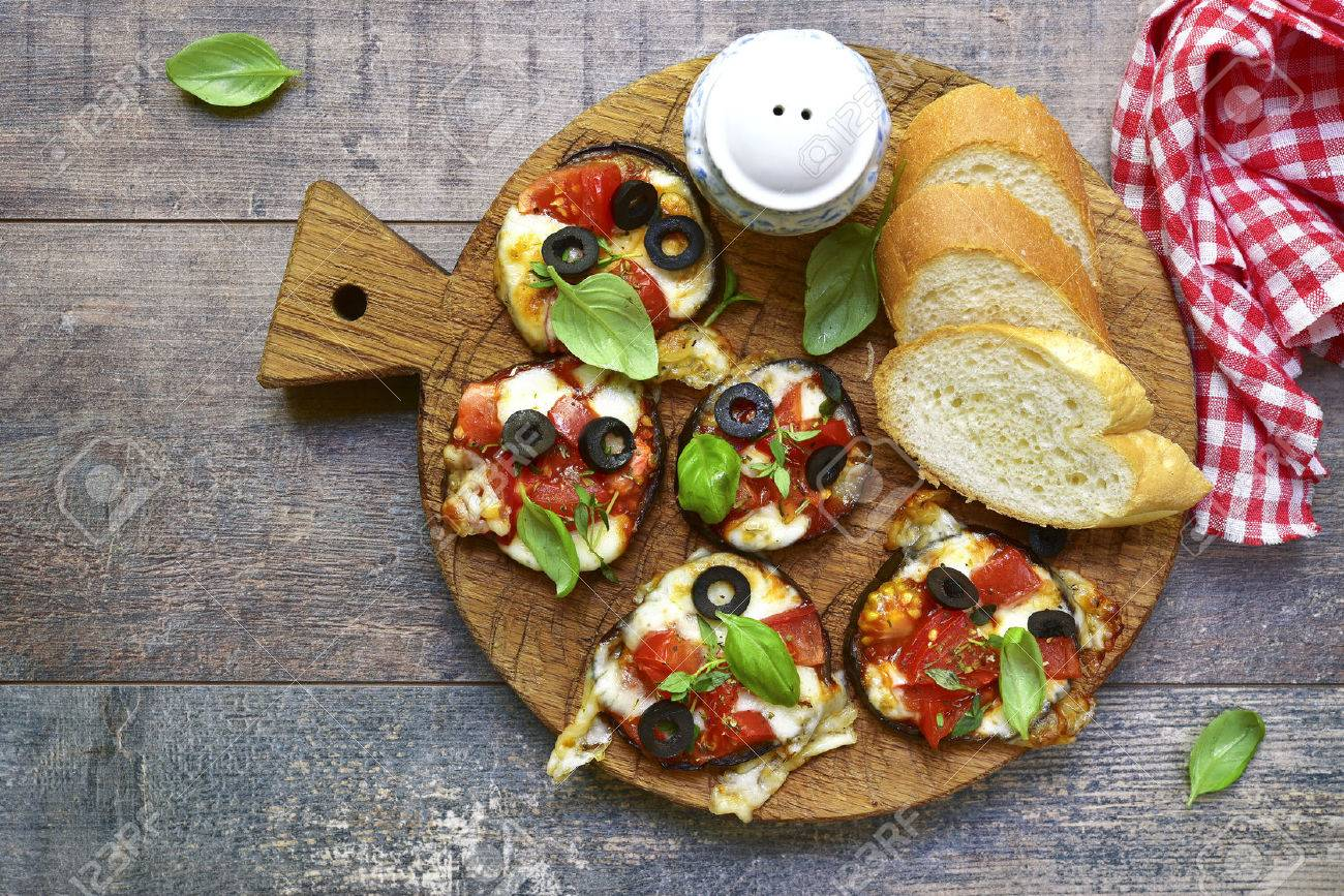 Pizza on a eggplant slices.Top view. - 58678658