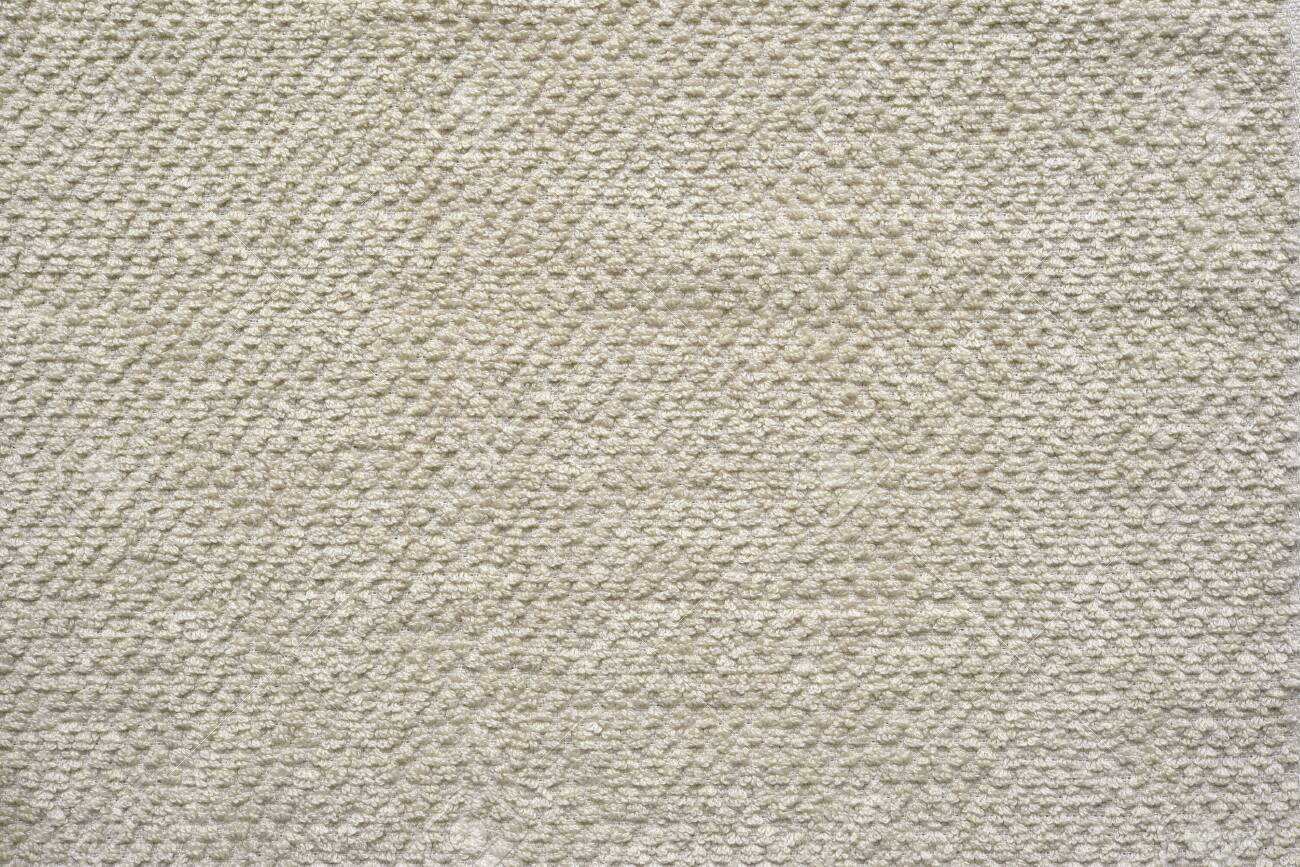 Light beige fabric texture.Bath or kitchen towel.