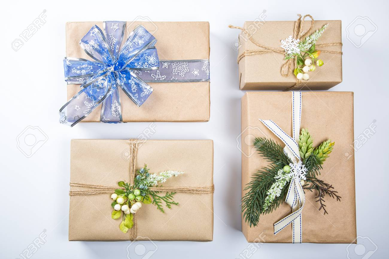classy christmas gifts box presents in brown paper new year decor on white merry