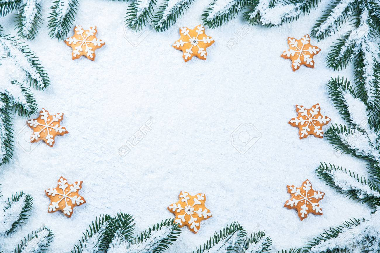 Christmas Background With Gingerbread Cookies With Snow And Tree