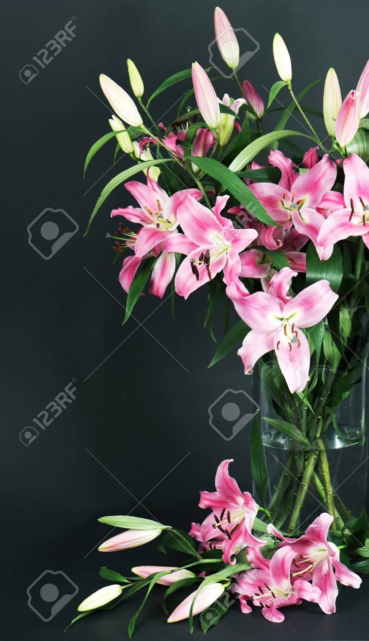 Lily Flowers Bouquet On Black Background Stock Photo Picture And