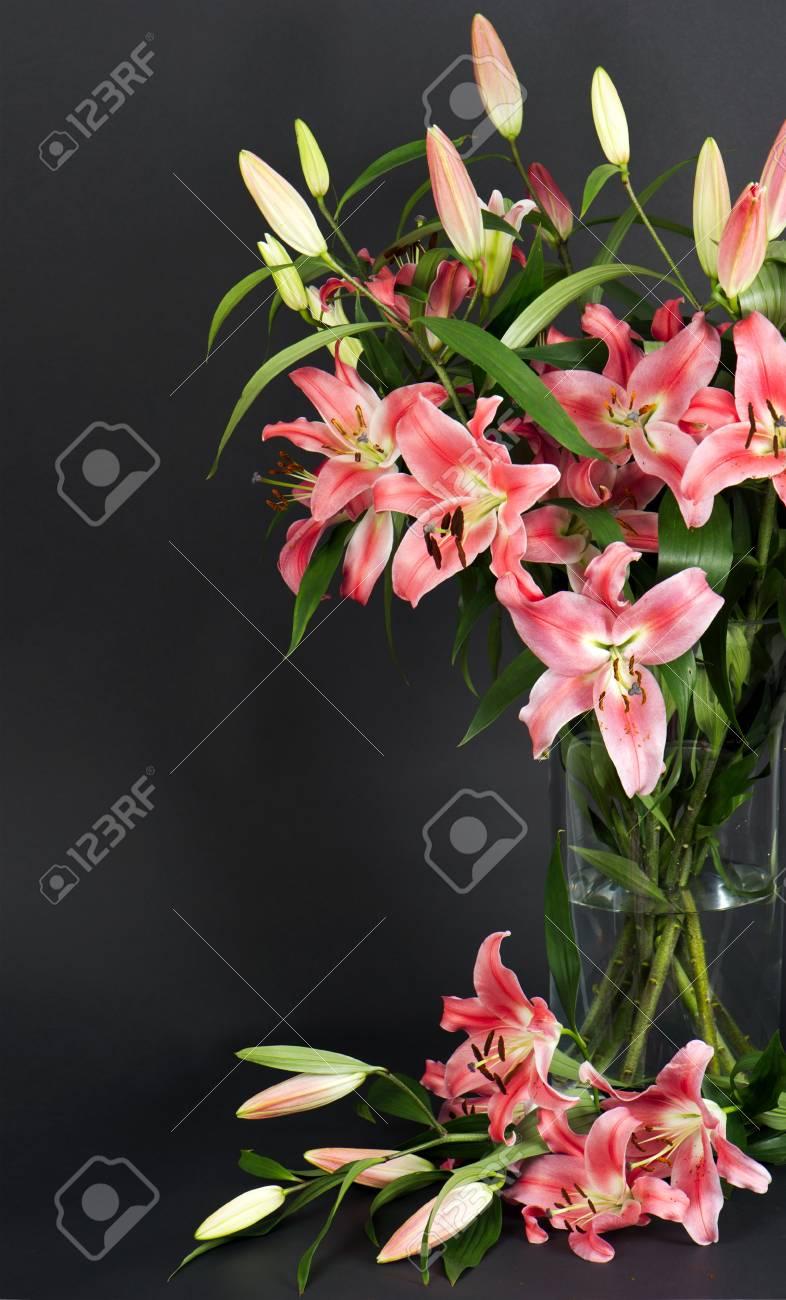 Lily flowers bouquet on black background stock photo picture and lily flowers bouquet on black background stock photo 21220802 izmirmasajfo