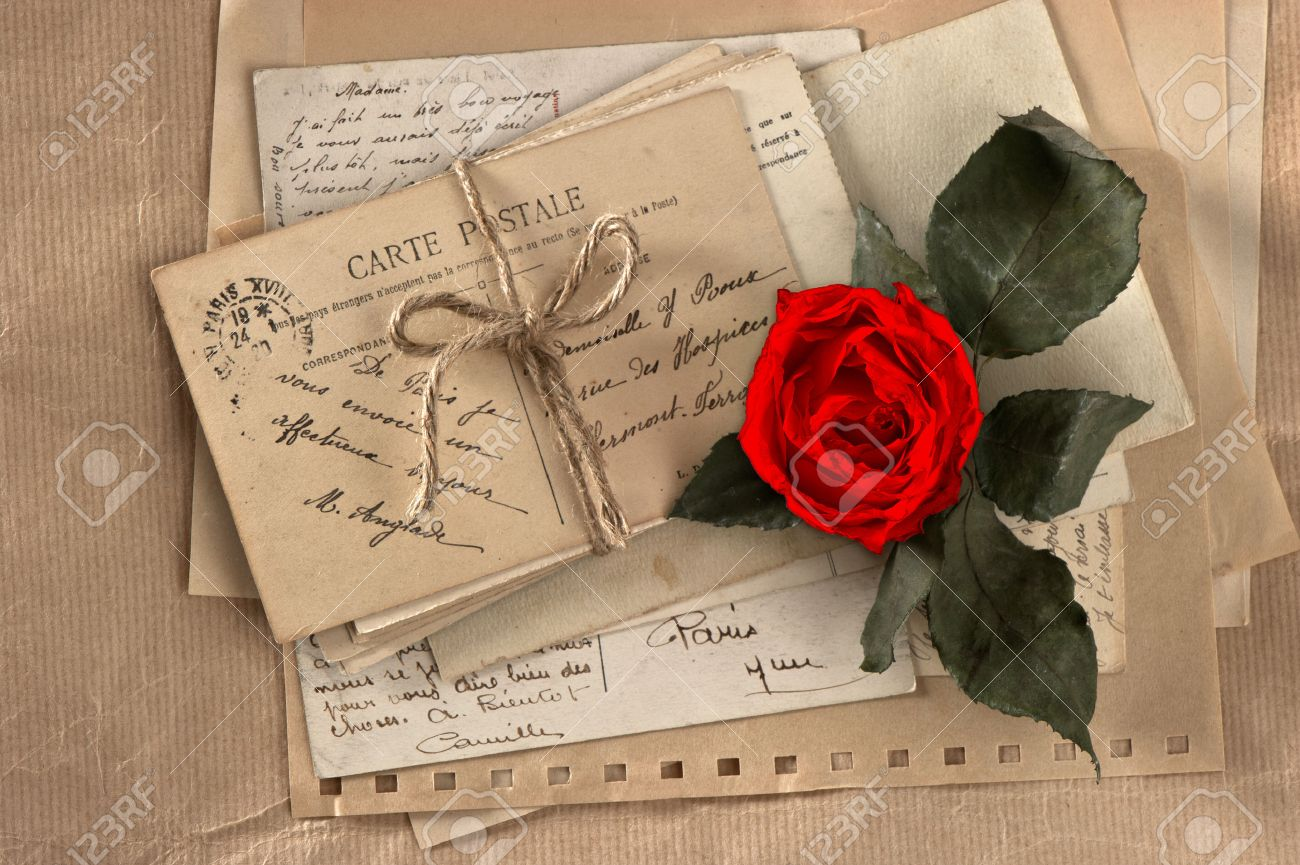 dry red rose and old love letters vintage postcards and envelopes, vintage  valentines day Stock