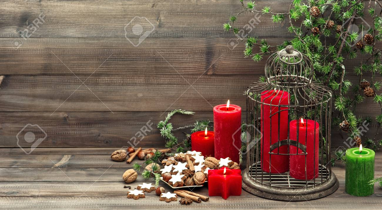 Christmas Decoration With Red Candles Birdcage And Pine Branch