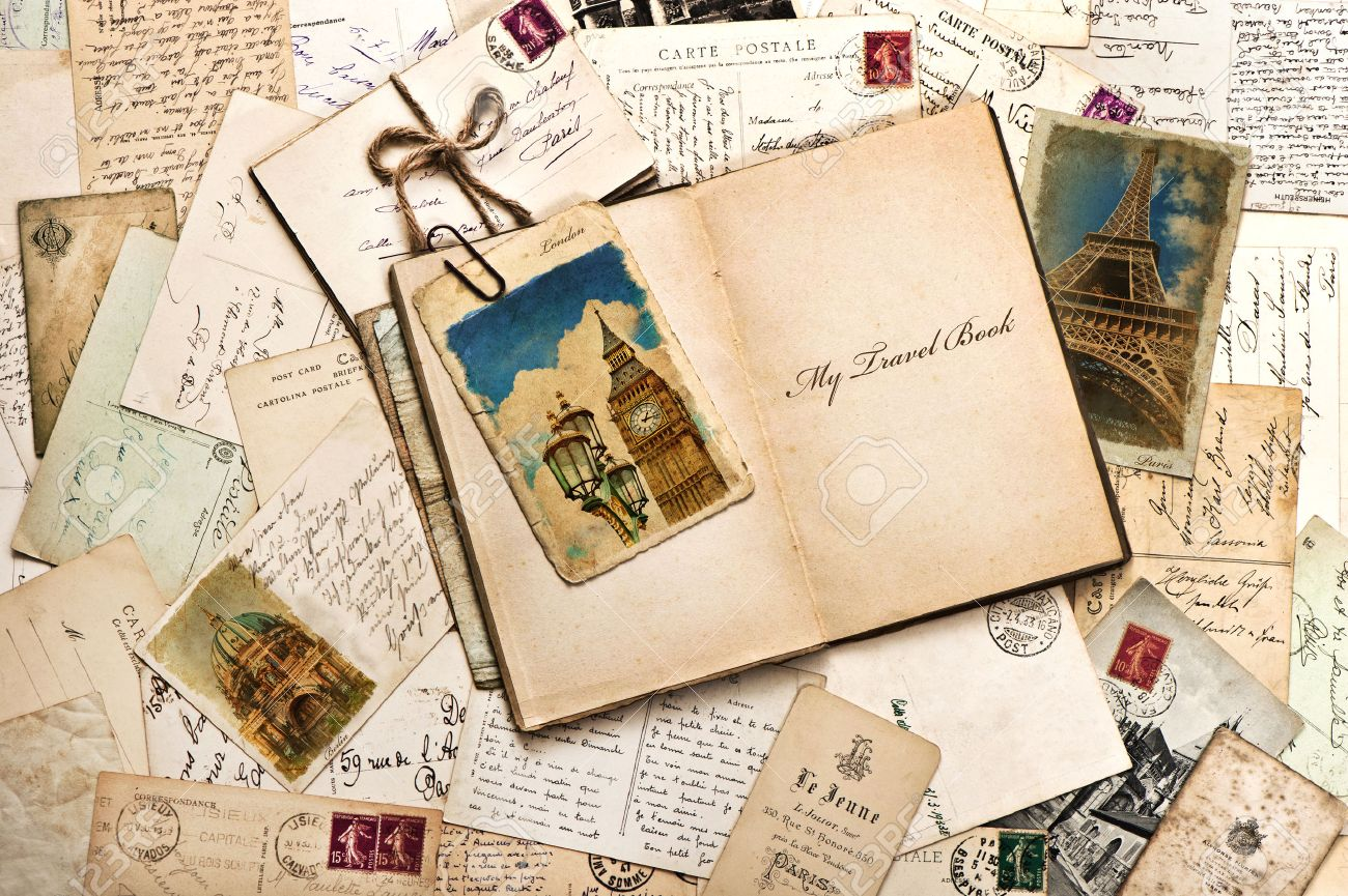 old postcards letters mails and open journal with sample text my travel book vintage