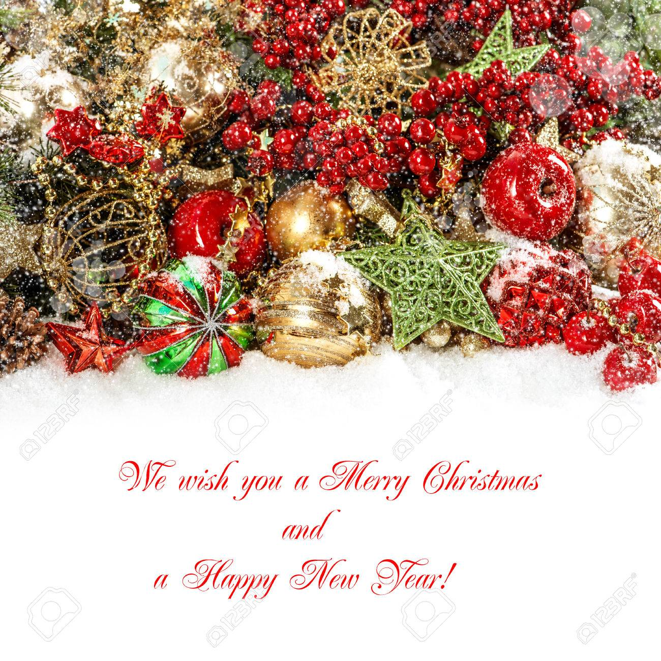 colorful christmas decorations in red gold green festive background with falling snow effect