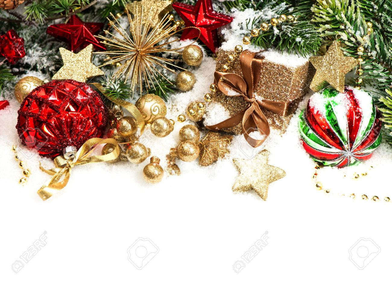 White christmas tree with red and green decorations - Christmas Decorations In Red Golden Green And Christmas Tree Branches On White Background Stock