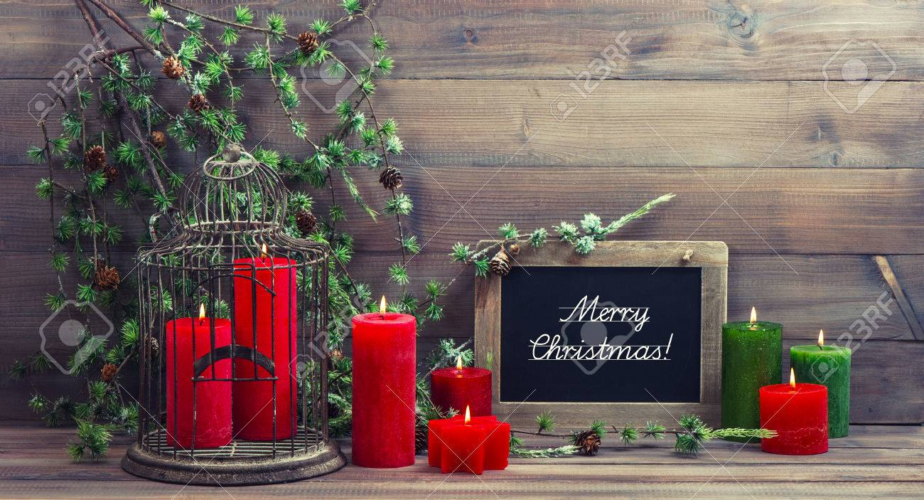 Vintage Christmas Decoration Birdcage, Red Candles And Pine Branch.  Nostalgic Home Interior With Blackboard