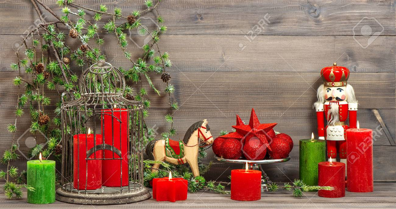 christmas decorations with red candles vintage toys nutcracker and rocking horse retro style toned