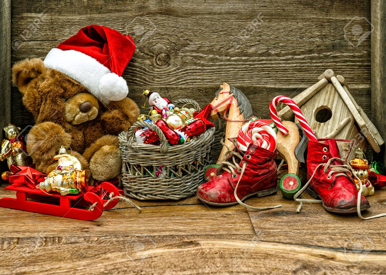 nostalgic christmas decorations with antique toys over wooden background stock photo 34117923