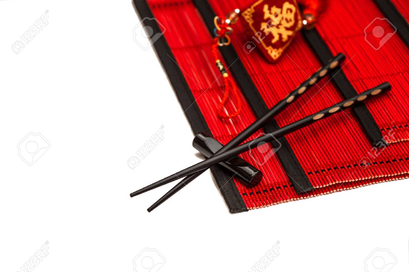 Black Chopsticks On Red Bamboo Mat. Asian Style Table Place Setting With  Chinese New Year