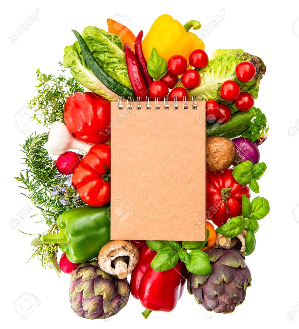 Recipe book with fresh organic vegetables and herbs isolated stock recipe book with fresh organic vegetables and herbs isolated on white background healthy food ingredients forumfinder Images
