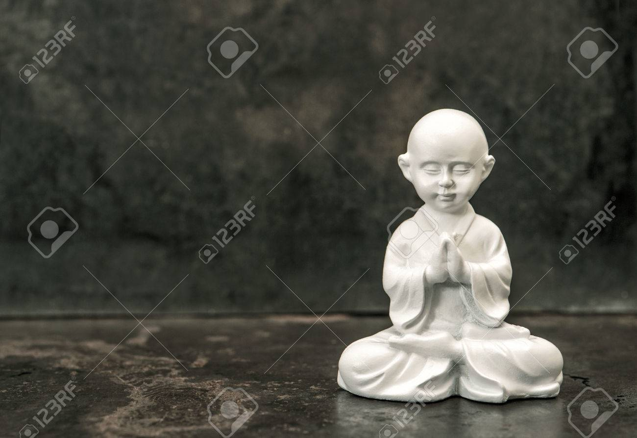 Buddha Statue On Dark Background Praying White Monk Meditation Concept Vintage Style Toned