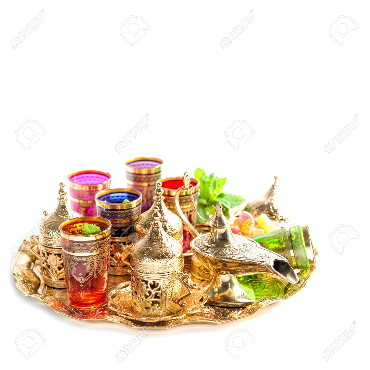 Tea glasses and mint leaves  Golden holidays decoration  Ramadan
