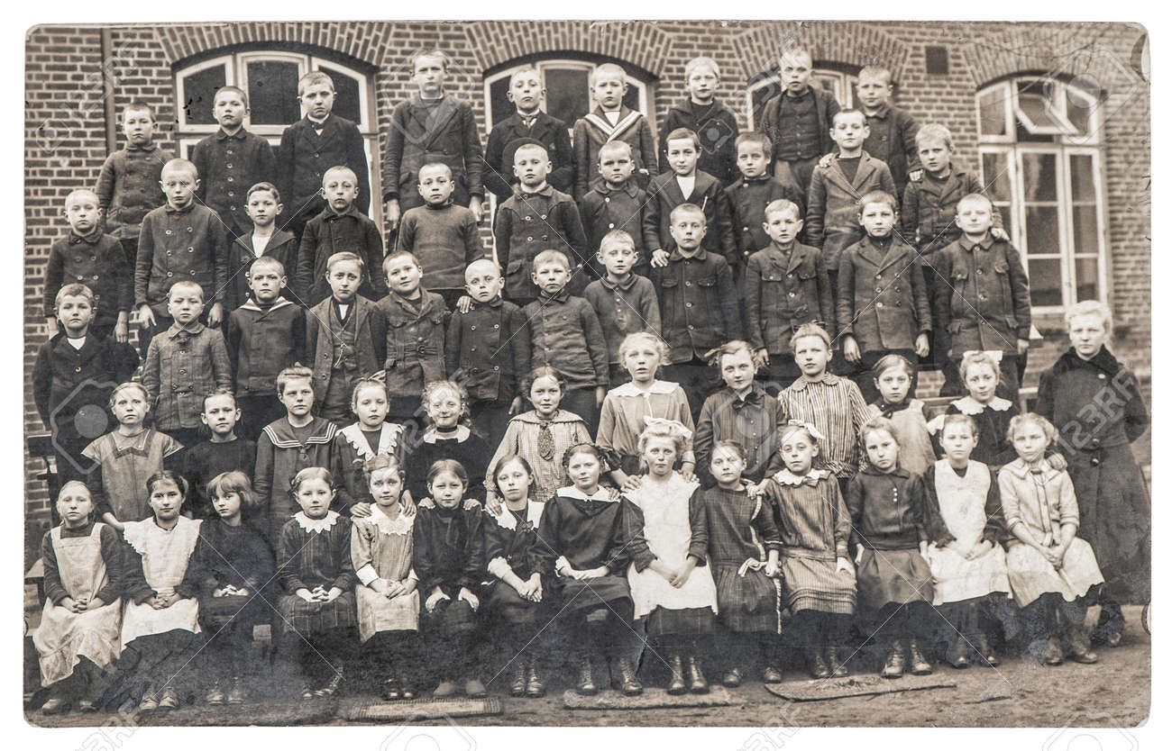 Old photo of school classmates. Group of children and teacher outdoors. Vintage picture with original film grain and blur - 155425637