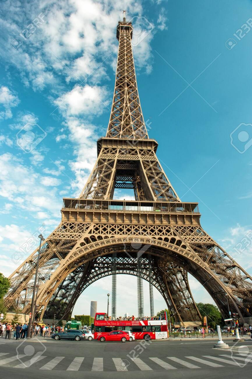 Eiffel Tower (La Tour Eiffel) in Paris over cloudy blue sky - 155896882