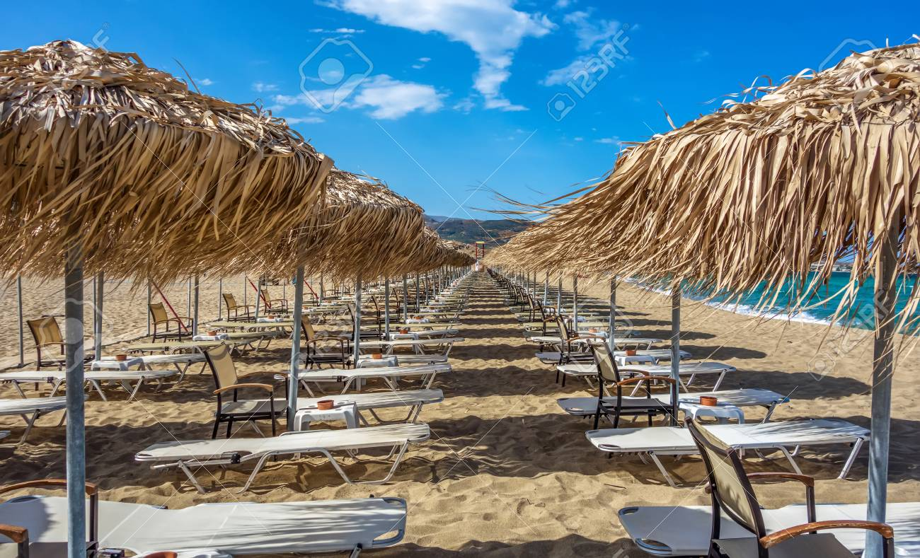 Rows Of Umbrellas And Sunbeds On Empty Beach Greece Crete