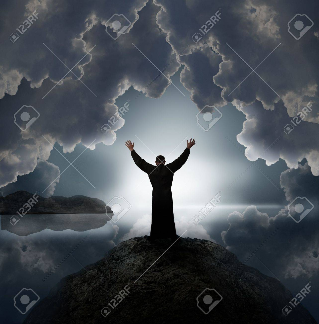 Man holding arms up in praise against sunset Stock Photo - 7574147