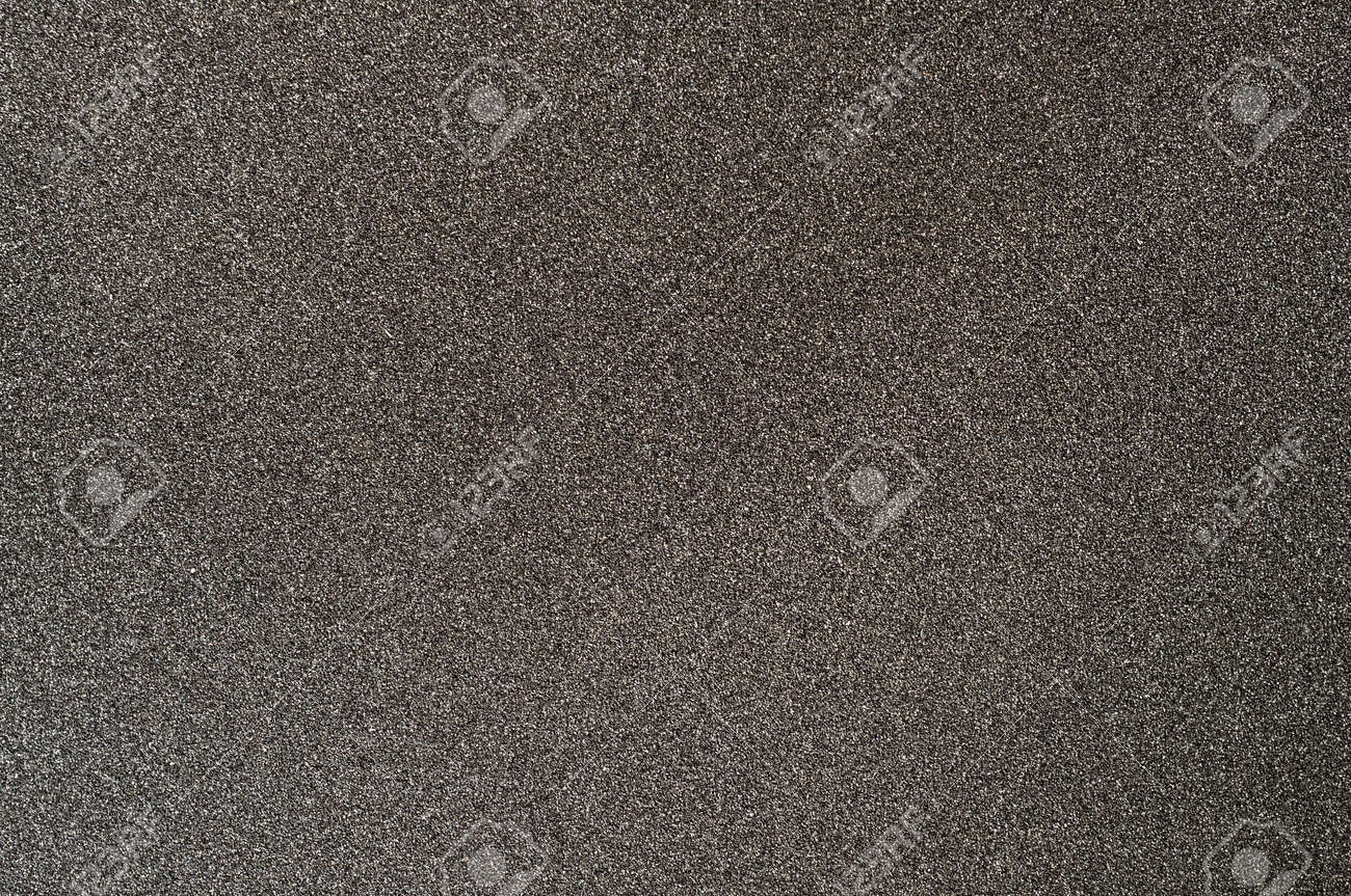 Black sandpaper textured background. Coated abrasive for making surface rougher - 131947412