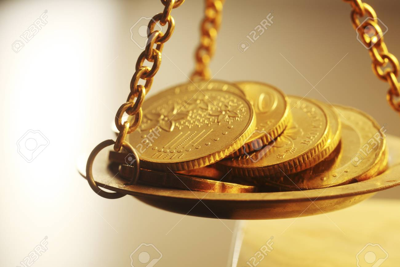 Stacks Of Bright New Shiny Gold Coins Placed On Weighing Scales Stock Photo, Picture And Royalty Free Image. Image 117836235.