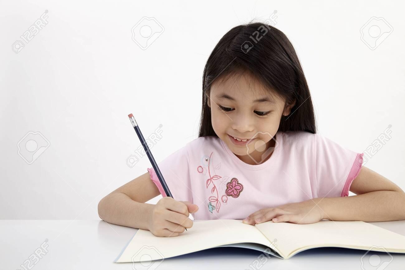 little girl writting doing homework - 120965460