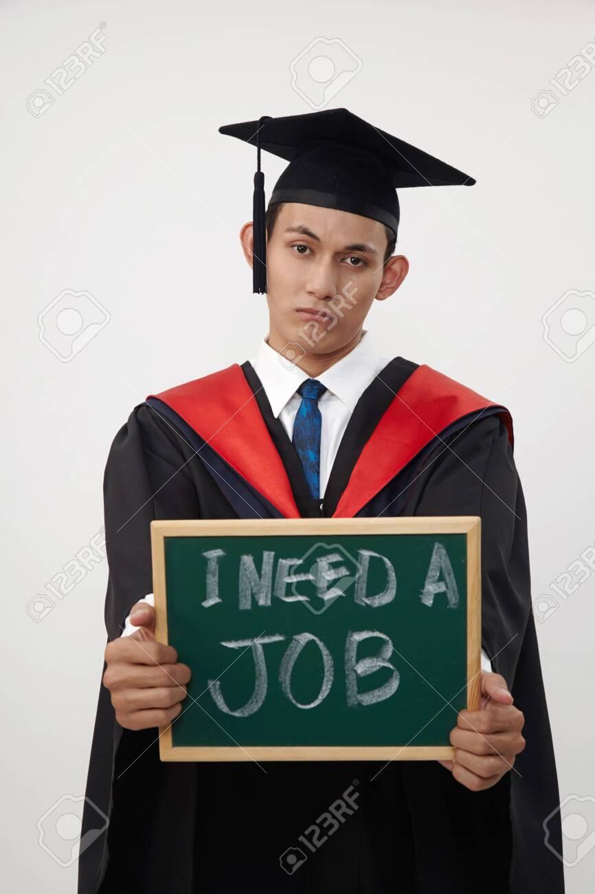 malay graduated student holding a blackboard written need a job - 122522794