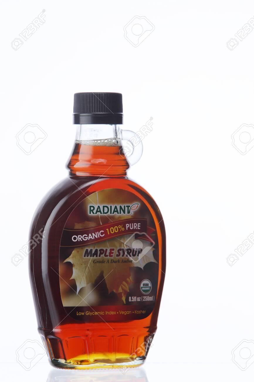 KUALA LUMPUR, MALAYSIA - Feb 17, 2016 radiant maple syrup on the white background - 129745869